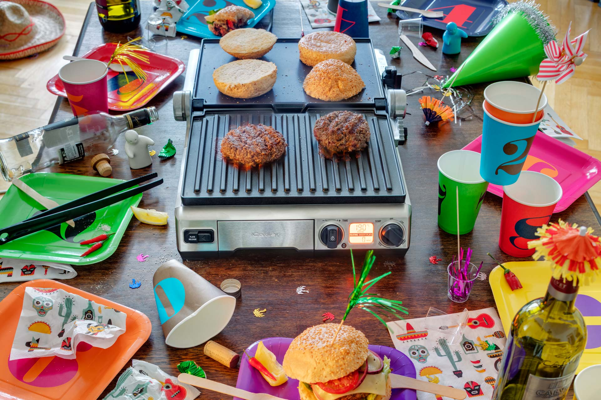 Grill with burger in a party setting