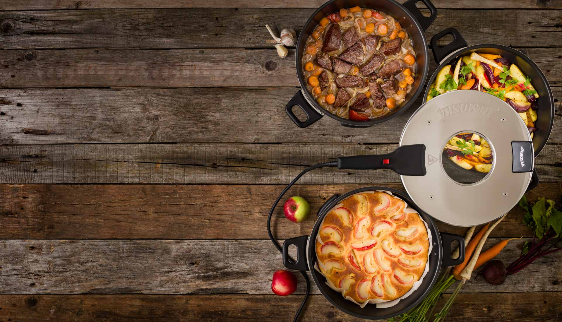 Remoska with three different recipes, backed beef, vegetables and cake