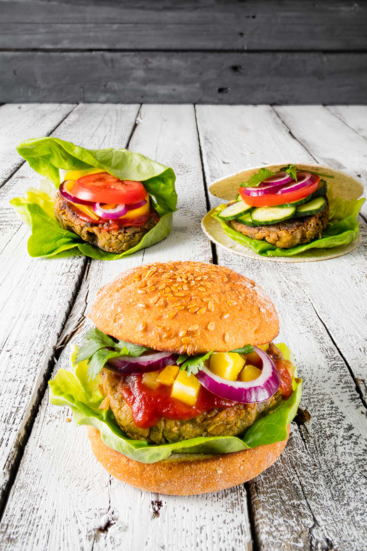 Vegan Burger in three variations, with salad, corn and gluten free bread