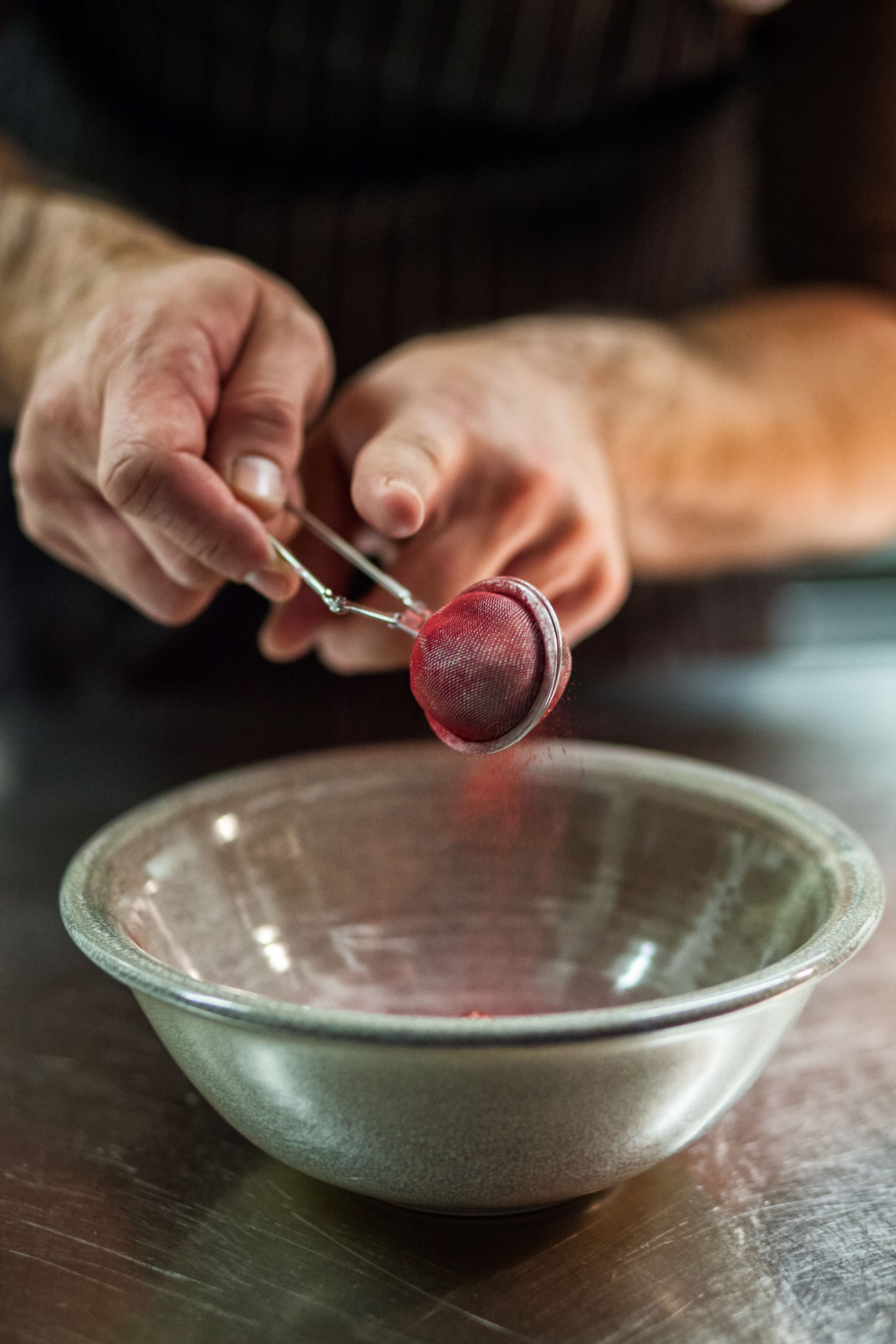 Michelin Star Chef Radek Kasparek preparing beetroot in the kitchen of his restaurant Field